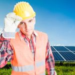Confident and polite engineer on solar power photovoltaic panel